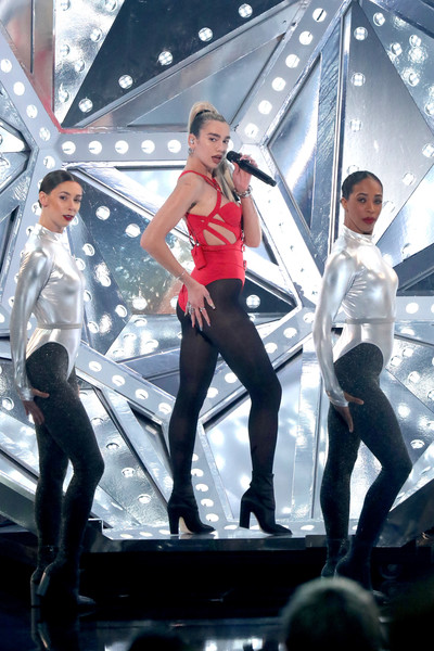 Dua Lipa Tights [performance,stage,performing arts,event,leggings,latex clothing,textile,latex,dancer,performance art,american music awards,microsoft theater,los angeles,california,dua lipa,show]