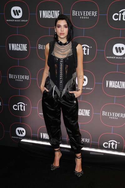 Dua Lipa Fringed Top [red carpet,clothing,fashion,carpet,leather,footwear,muscle,dress,fashion design,performance,fashion model,warner music pre-grammy party,nomad hotel,los angeles,california,dua lipa,dua lipa,trousers,photography,getty images,harem pants,grammy awards,skirt,strapless dress]