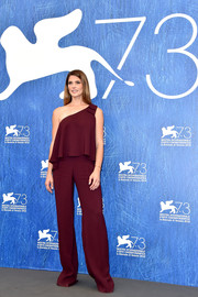Ashley Greene went for casual sophistication in a loose burgundy one-shoulder top by Saloni for the 'In Dubious Battle' photocall at the Venice Film Festival.