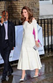 Kate Middleton added sparkle to her step with a pair ice-blue pumps by Jimmy Choo.