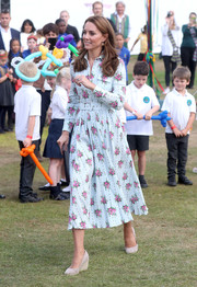Kate Middleton looked charming in a belted floral shirtdress by Emilia Wickstead at the Back to Nature Festival.