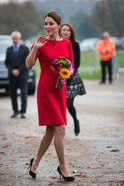 Kate Middleton showed off her royal style in a red shift dress by Katherine Hooker while visiting Norfolk, England.