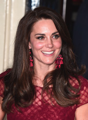 Kate Middleton matched her burgundy dress with a pair of Kate Spade tassel earrings.