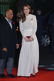 Kate Middleton kept it classy in a long-sleeve white lace-bodice gown by Self-Portrait at the UK premiere of 'A Street Cat Named Bob.'