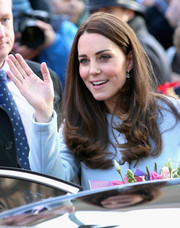 Kate Middleton left her long hair loose with flippy ends for a morning event in Kensington.