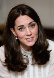 Kate Middleton styled her hair with a center part and bouncy, flippy ends for her guest-editing stint at Huffington Post.