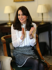 Kate Middleton looked demure in a long-sleeve, high-neck white blouse by Reiss while guest editing the Huffington Post.