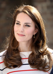 Kate Middleton looked absolutely darling with her flowing curls while hosting a reception for runners.