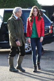 Kate Middleton went casual in skinny jeans, a green sweater, and a red puffer jacket for a visit to Peterley Manor Farm.