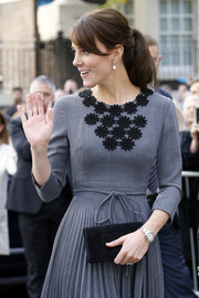 Kate Middleton accessorized with a Ballon Bleu de Cartier watch for a Chance UK Early Intervention Programme event.