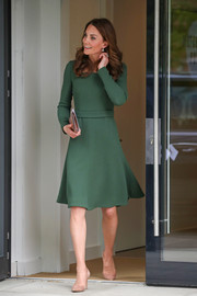 Kate Middleton opted for a simple long-sleeve green dress by Emilia Wickstead when she attended the opening of the Anna Freud Centre of Excellence.