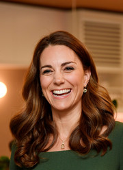 Kate Middleton matched her earrings with an amethyst pendant necklace, also by Kiki McDonough.