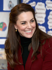 Kate Middleton completed her look with a pair of dangling citrine and diamond earrings by Kiki McDonough.