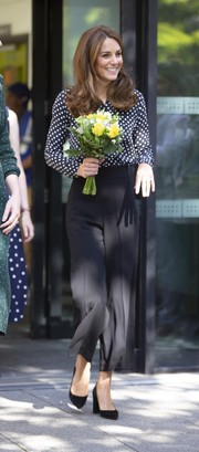 Kate Middleton kept it classic in a black-and-white polka-dot blouse by Equipment while visiting Sunshine House.