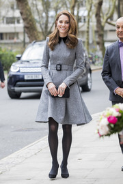 Kate Middleton kept it modest and classy in a collared gray dress by Catherine Walker while visiting the Foundling Museum.