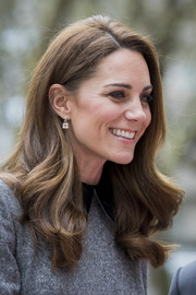 Kate Middleton looked so pretty wearing this loose hairstyle with curly ends while visiting the Foundling Museum.