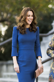 Kate Middleton paired a nude leather clutch by Mulberry with a blue sheath dress for a visit to the Imperial War Museum.