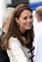 Kate Middleton wore her hair with a side part and flippy ends during her visit to Land Rover BAR.