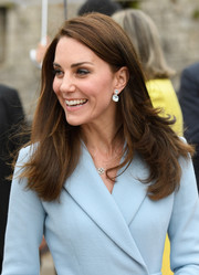 Kate Middleton matched a pair of dangling topaz earrings by Kiki McDonough with a pastel-blue coat dress for her visit to the Drai Eechelen Museum in Luxembourg.