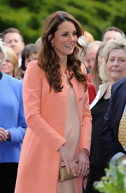 The Duchess of Cambridge stuck to her signature wavy 'do for a trip to a children's hospital.