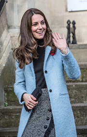 Kate Middleton visited the Nelson Trust Women's Centre wearing a sky-blue Mulberry wool coat over a black turtleneck and a tweed skirt.