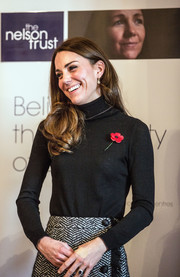 Kate Middleton was fall-chic in a black turtleneck and a tweed skirt while visiting the Nelson Trust Women's Centre.