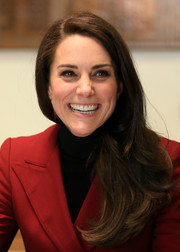 Kate Middleton wore her long flippy hair swept to the side while visiting the RAF Air Cadets at RAF Wittering.
