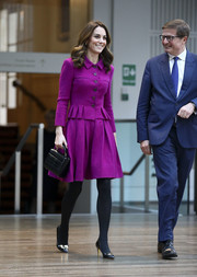 Kate Middleton teamed embellished black pumps by Rupert Sanderson with a magenta skirt suit for her visit to the Royal Opera House.