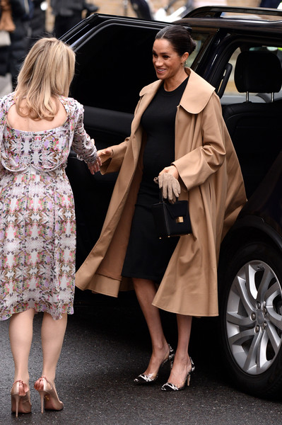 Meghan Markle styled her look with a pair of printed plexi pumps by Gianvito Rossi.