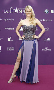 Natascha Gruen wore a pair of strappy silver sandals with her lavender and purple gown at the 2012 Dufstar Awards.