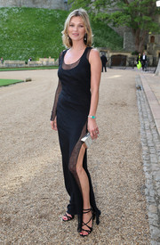 Kate Moss looked sultry at the Royal Marsden celebration in a one-sleeve black Ralph Lauren evening dress featuring sheer accents and a thigh-high slit.