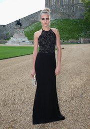 Cara Delevingne donned a black Ralph Lauren halter gown with an embellished bodice for the Royal Marsden celebration.