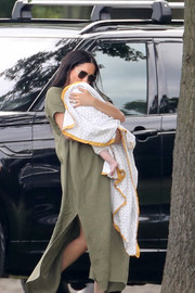 Meghan Markle kept it breezy in a loose olive-green maxi dress by Lisa Marie Fernandez at the King Power Royal Charity Polo Day.