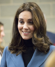 Kate Middleton sported a shoulder-length 'do with bouncy, curly ends at the Coach Core graduation.