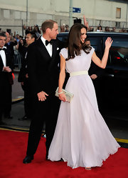 Kate Middleton gave her stunning lilac gown a glittery finish with a silver Ubai envelope clutch.