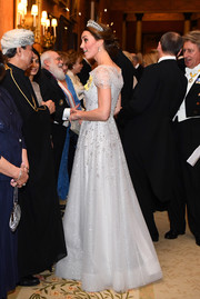 Kate Middleton looked downright divine in a beaded ice-blue gown by Jenny Packham while attending a reception for members of the Diplomatic Corps.