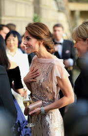 Kate Middleton paired a dusty-rose satin clutch by Prada with a Jenny Packham rewear for the gala dinner supporting East Anglia's Children's Hospices.