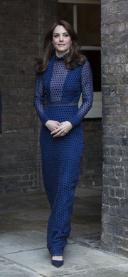 Kate Middleton looked classy and elegant in a dotted blue evening dress by Saloni while attending a reception at Kensington Palace.