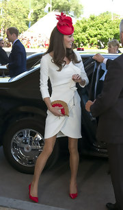 Kate Middleton accented her chic white dress with a beaded red and gold fan clutch.