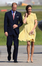 Prince William wore his signature navy suit for the Cambridge Canadian Tour with Kate.