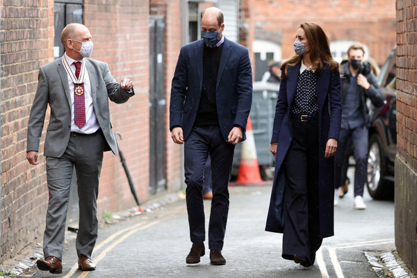 Kate Middleton twinned with Prince William in a long navy coat by Catherine Walker while visiting Base25 to mark mental health awareness week.