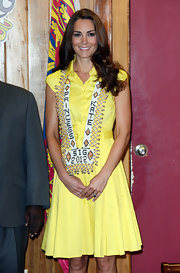A cheery yellow frock made Kate Middleton look happy and bright.