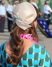 Nobody does a decorative hat quite like the Duchess, and this raffia-woven topper was as elegant a choice as ever.