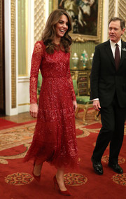 Kate Middleton sparkled in a red sequined dress by Needle & Thread while attending a reception to mark the UK-Africa Investment Summit.