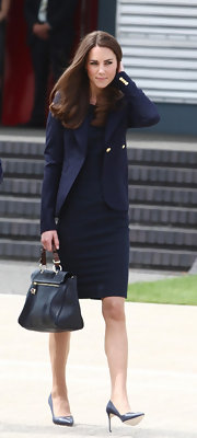 Kate Middleton prepared to depart Canada in a pair of sophisticated navy leather pumps.