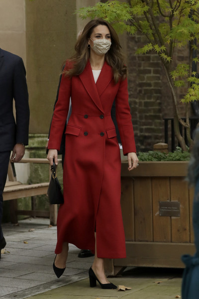 Kate Middleton attended the launch of the 'Hold Still' community exhibition wearing a classic red coat by Alexander McQueen.