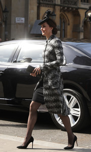 Kate Middleton teamed her stylish coat with sheer tights and black pumps.