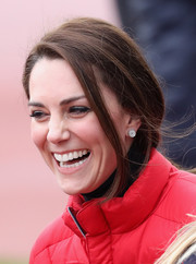 Kate Middleton accessorized with a cute pair of diamond button studs by Asprey while attending a London Marathon training.