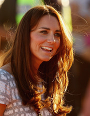 Kate Middleton left her long hair loose with layered ends for her visit to Ayers Rock.