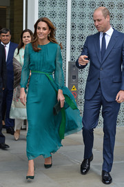 Kate Middleton complemented her frock with a green suede clutch by Emmy London.